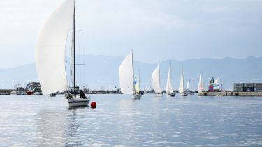 Sailboats entering the finish of the Fiumanka regatta in Rijeka, Croatia.