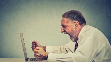 Angry man shouting at computer