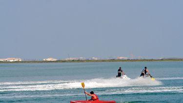 Kayaker and jet skiiers