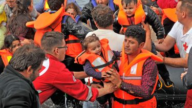Volunteer rescuers helping refugees on Lesvos in Greece
