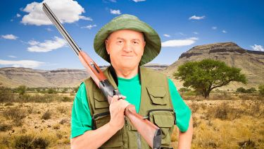 Male hunter holding shotgun