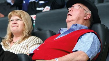 man asleep in crowd