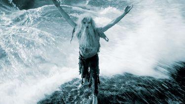 Man marooned on rock in ocean