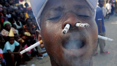Man smoking cigarettes with ears and nostrils