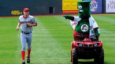Mascot mocking baseball player