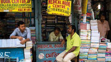 Men looking after book stalls, College Street, Kolkata, India