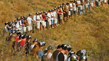 Miners standing in a line in a field