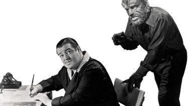 Monster behind man at desk