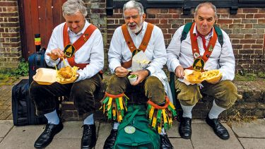 Morris dancers eat fish and chips