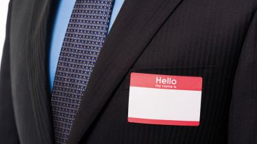 Businessman wearing blank name badge