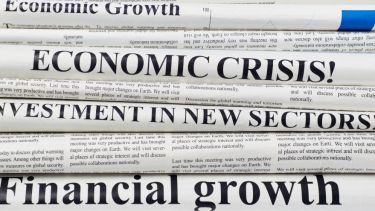 Newspaper front pages with economics headlines
