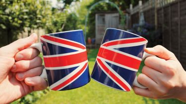 People holding Union Jack flag tea cups