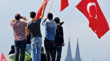 People waving Turkish flag