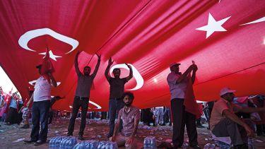 People underneath a Turkish flag