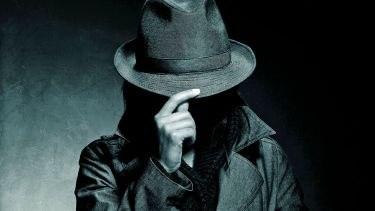 Person hiding face with hat brim