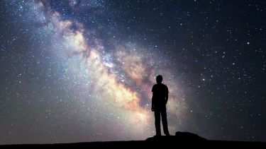 Person looking at starry night sky