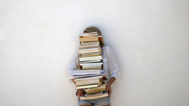 Student with pile of books