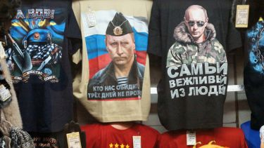 Russian president Vladimir Putin pictured on t-shirts in a Moscow shop