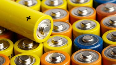 Rows of multi-coloured AA batteries