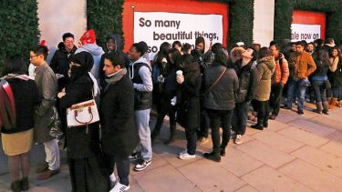 Shoppers queue outside Selfridges department store, London
