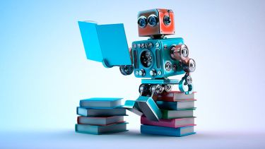 Small robot sitting on pile of books, reading