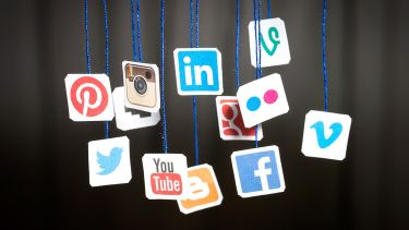 Social media icons hanging from blue string