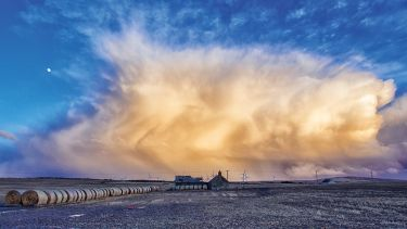 Storm gathering over farmland