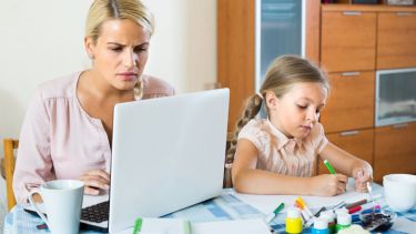 stressed-woman-with-child-working-from-home
