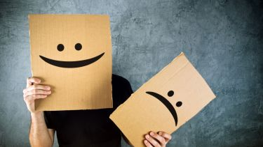 Happy and sad cardboard faces