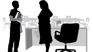 Student silhouette talking to teacher