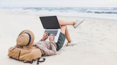 Working with a laptop on the beach
