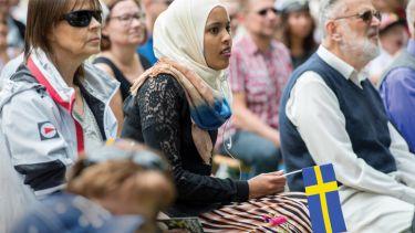 Swedish people participating in National Day of Sweden celebrations, Norrköping, Sweden