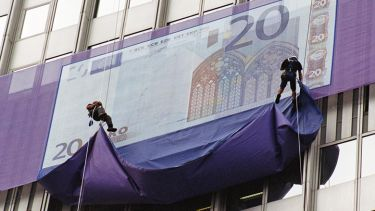 giant Euro note being unveiled by abseilers. Money