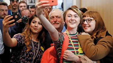 Jeremy Corbyn, the leader of Britain's opposition Labour Party, poses for selfies at a campaign event in Leeds, May 10, 2017