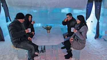 Tourists drinking, Balea Lac Hotel of Ice, Făgăraș Mountains
