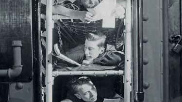 Sailors in bunk beds in submarine