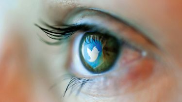 Twitter logo reflected on person's eye