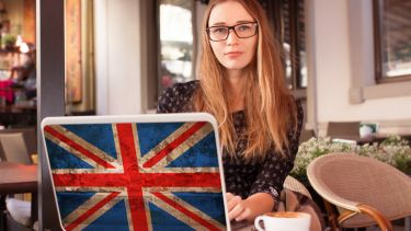 Student with British laptop