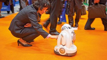 Woman interacting with robot