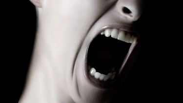Woman screaming (close-up)