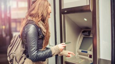 Woman gets money out of cashpoint