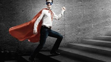 Young man standing on stairs dressed as superhero