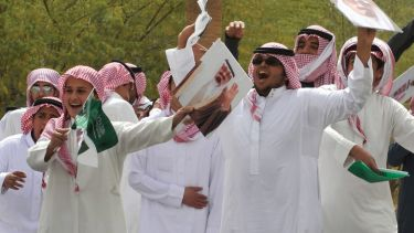 Young Saudi men cheering and celebrating