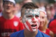 Young man with American flag painted on face
