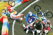 Group of BMX riders fall during race