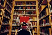 Person reading books in library