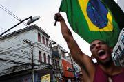 Man waves Brazilian flag