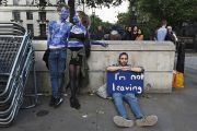 A young couple painted as EU flags protest on outside Downing Street against the United Kingdom's decision to leave the EU following the referendum
