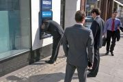Business men at ATM