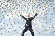 Businessman celebrates with money